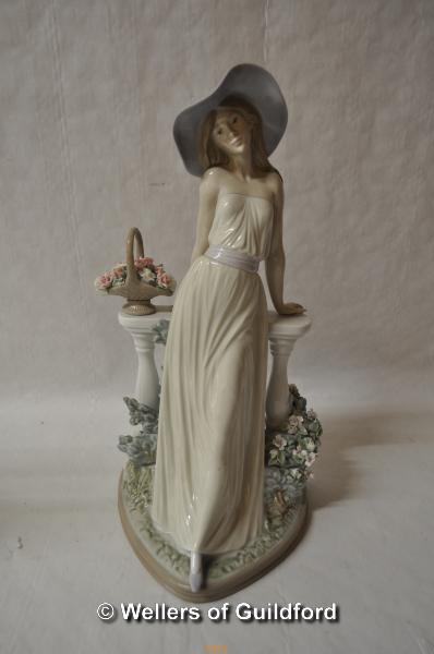 Lot 7477 - Lladro figure of a lady wearing a large hat leaning on a balustrade, 35cm.