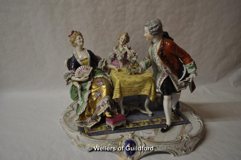 Lot 7397 - A large Samson figure group of three figures gathered round a table, 41cm wide.