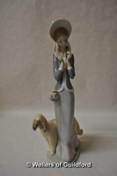 Lot 7476 - Lladro figure of a lady with an Afghan hound, 33cm.