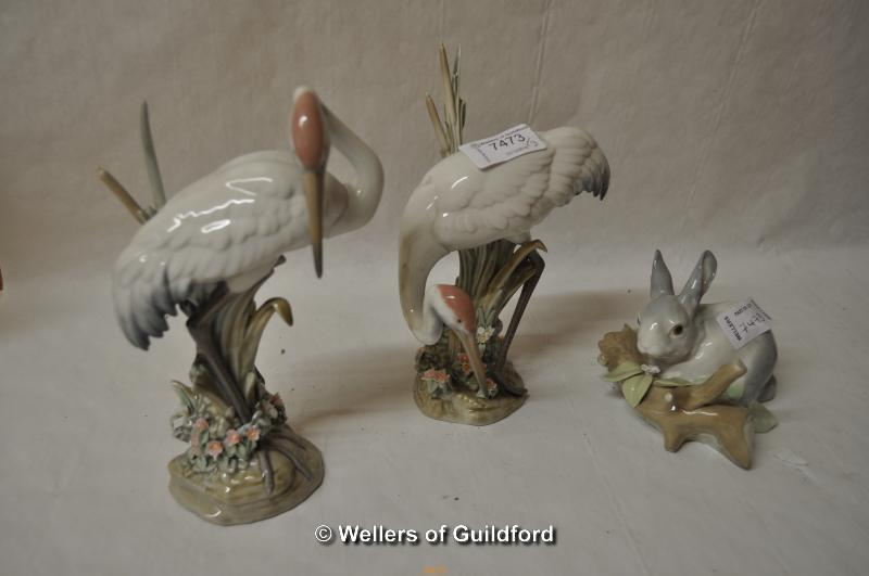 Lot 7473 - Lladro: a pair of cranes and a rabbit sitting by a log, the tallest 19.5cm (3)