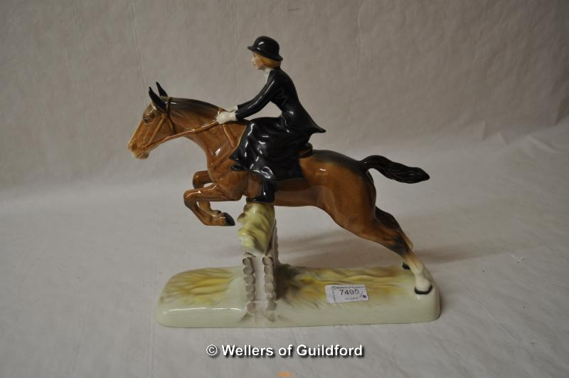 Lot 7495 - Beswick figure of a lady riding sidesaddle jumping over a fence, 26cm.