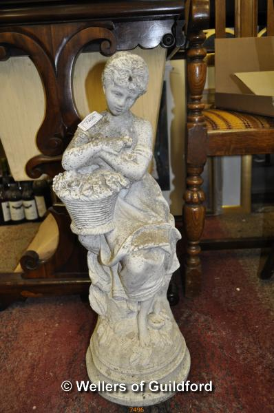 Lot 7496 - A small garden statue of a woman carrying basket of flowers, 62cm.