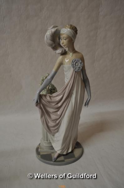 Lot 7480 - Lladro figure of a lady in flowing dress beside an urn of foliage, 34cm.