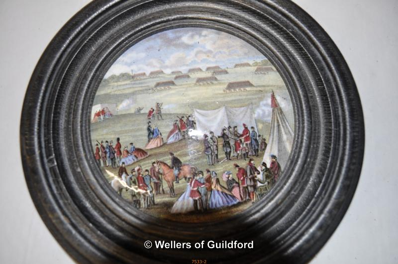Lot 7533 - Two Victorian pot lids, The Village Wedding and one other, both framed.