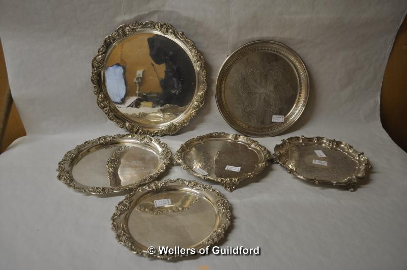 Lot 7304 - A graduated set of three circular silver plated trays with grapevine borders; three further silver