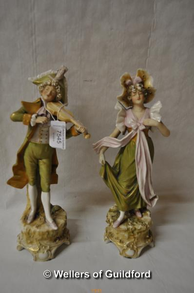 Lot 7545 - A pair of Royal Dux classical figurines, impressed numbers 391 and 392, he is playing the fiddle and