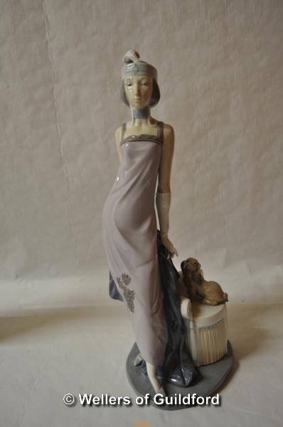 Lot 7479 - Lladro figure of a 1920's style lady with a dog seated on a chair, 33cm.