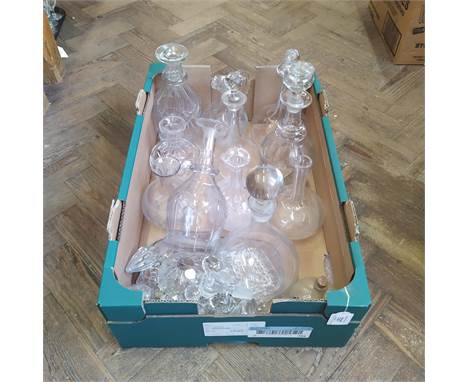 A collection of mixed cut glass items including decanters, odd stoppers and a part lustre