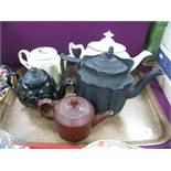 An XVIII Century Leeds Creamware Teapot, with intertwined handles (damages), black glazed Jackfield