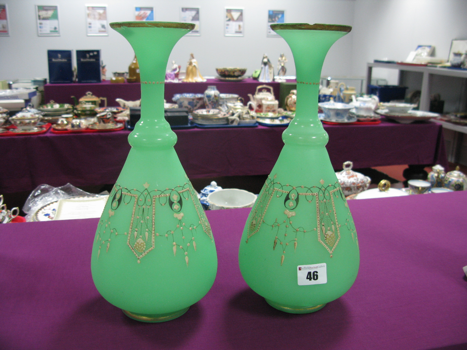 A Pair of Late XIX Century Green Glass Vases, with cream and black overlay to ovoid bodies, fluted
