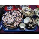 An Early XIX Century Miles Mason Teapot, matching cups and saucers; a collection of Imari plates