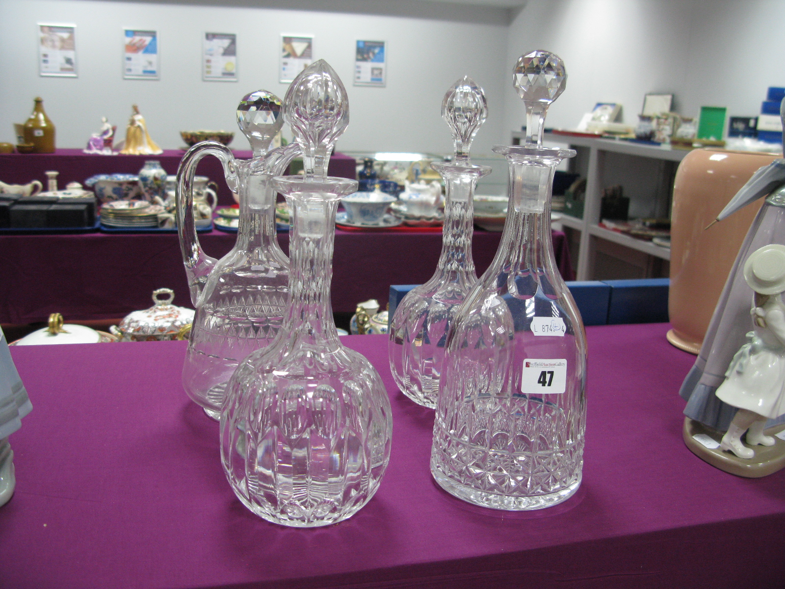 Lot 47 - A Pair of Bulbous Faceted Decanters, bell shaped example, claret jug.