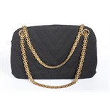 A Chanel chevron quilted black jersey handbag, 1960s,