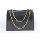 A Cartier blue/black lizard handbag with alternative pouches, 1960s, Varanus Salvator,