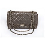 A Chanel quilted brown leather flap bag, 1960s, stamped in gold to the interior 'Chanel',