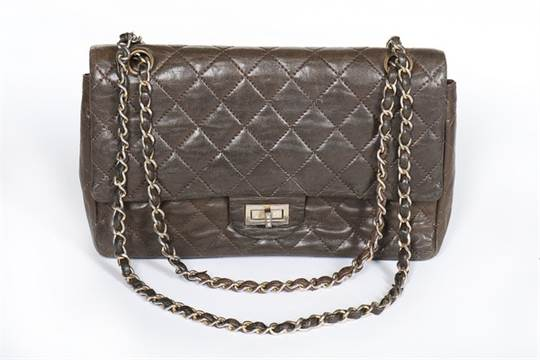 337d4b808244bb A Chanel quilted brown leather flap bag, 1960s, stamped in gold to ...