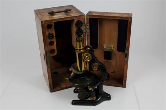 Antique carl zeiss jena microscope no. 87168 housed within wooden
