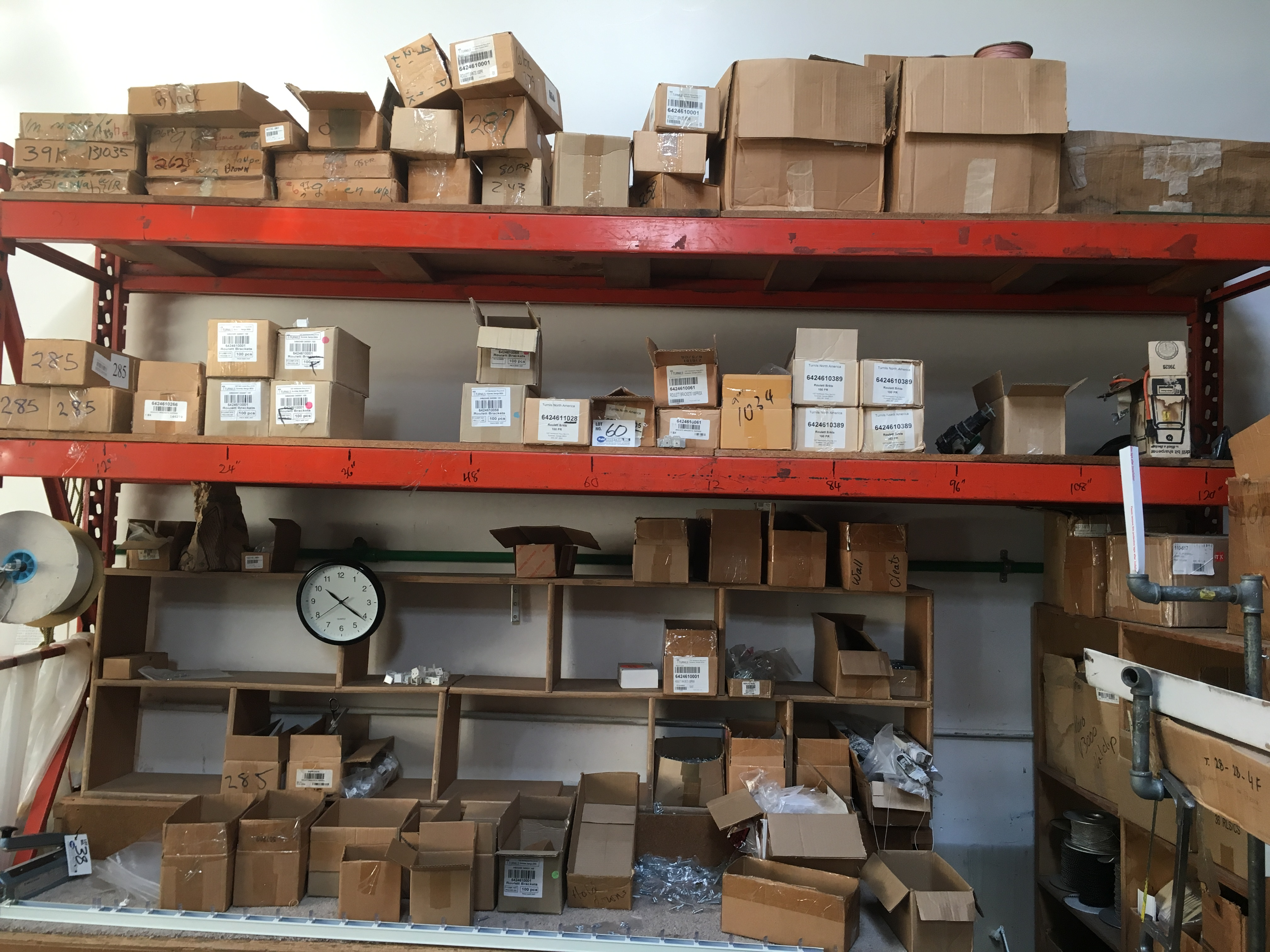 Lot 60 - Large Assortment of Roulette Brackets and assorted hardware on rack and bench