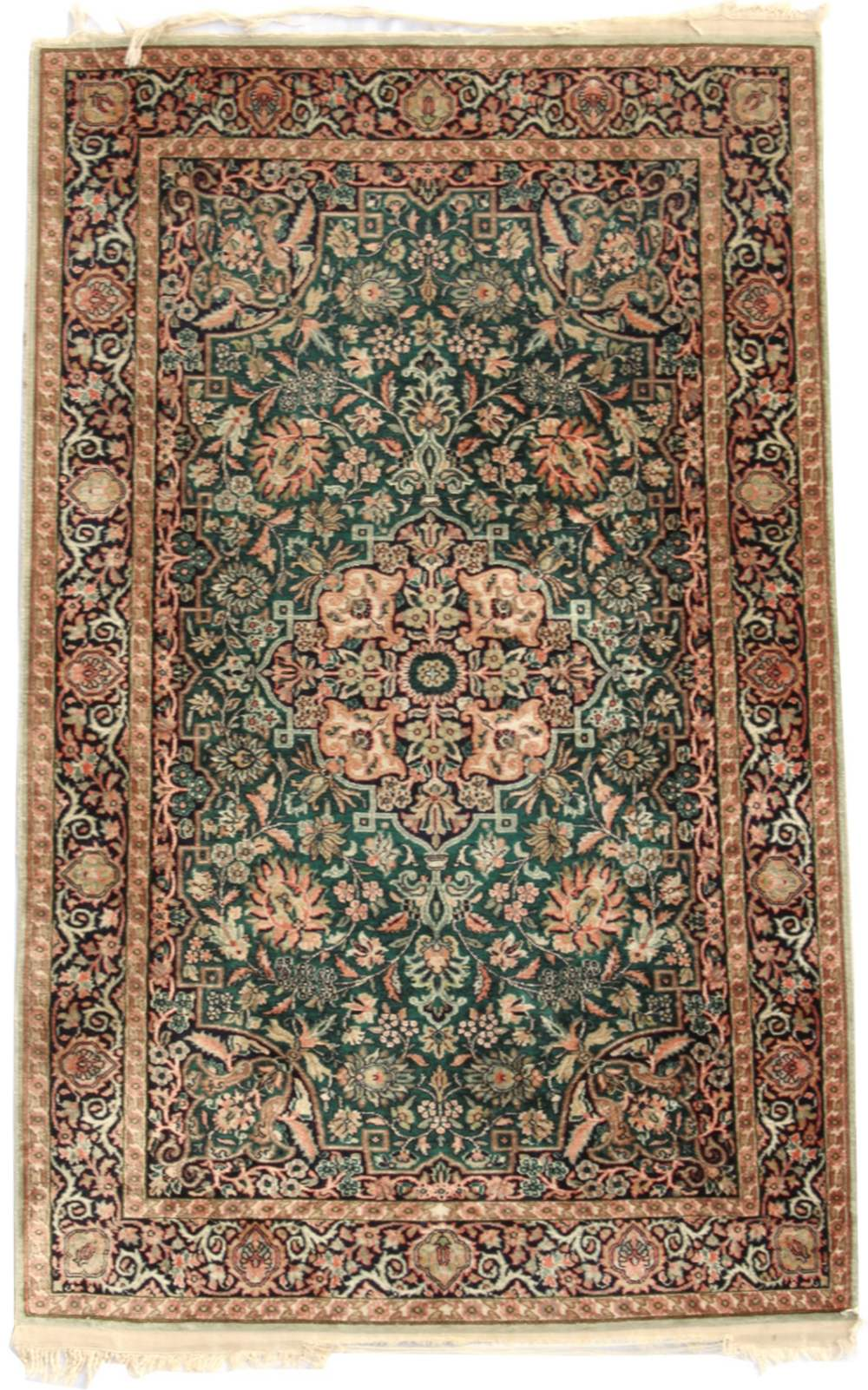 Property of a deceased estate - a silk rug, with green field, 49 by 31ins. (125 by 79cms.) (see