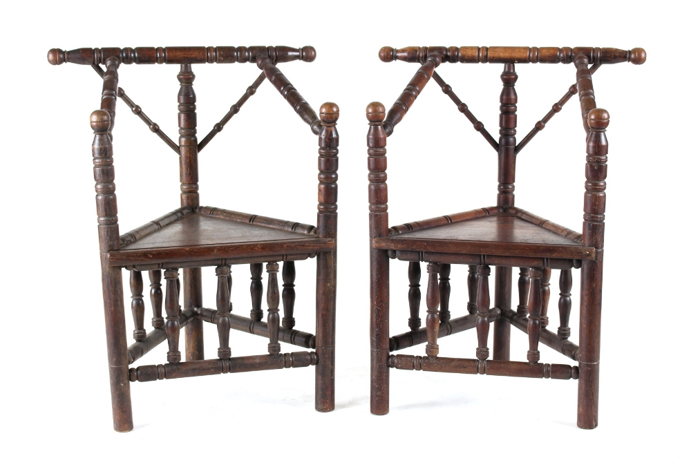 A pair of late Victorian oak turner's chairs (2) (see illustration).