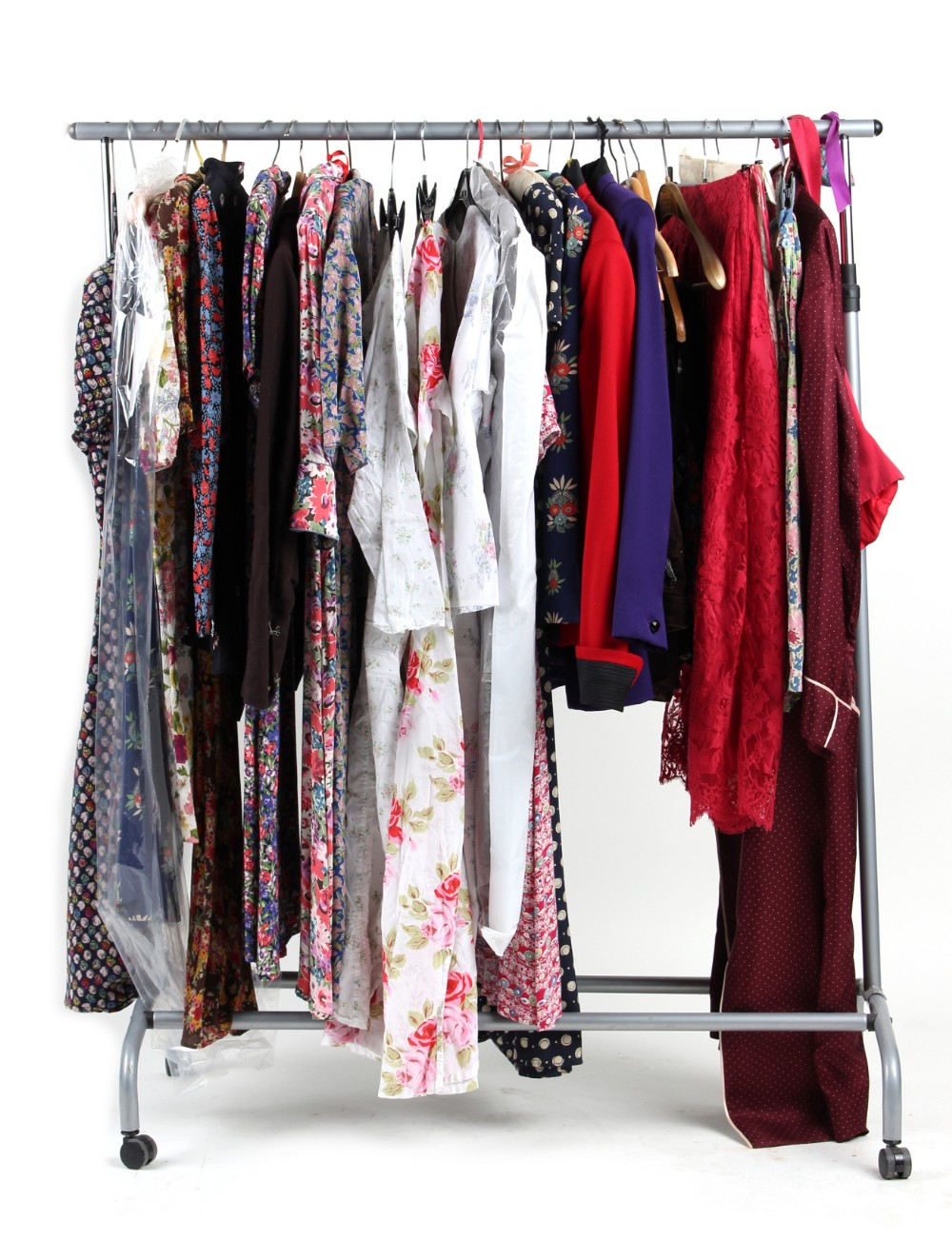 Property of a deceased estate - a quantity of lady's clothing including dresses, jackets and skirts,