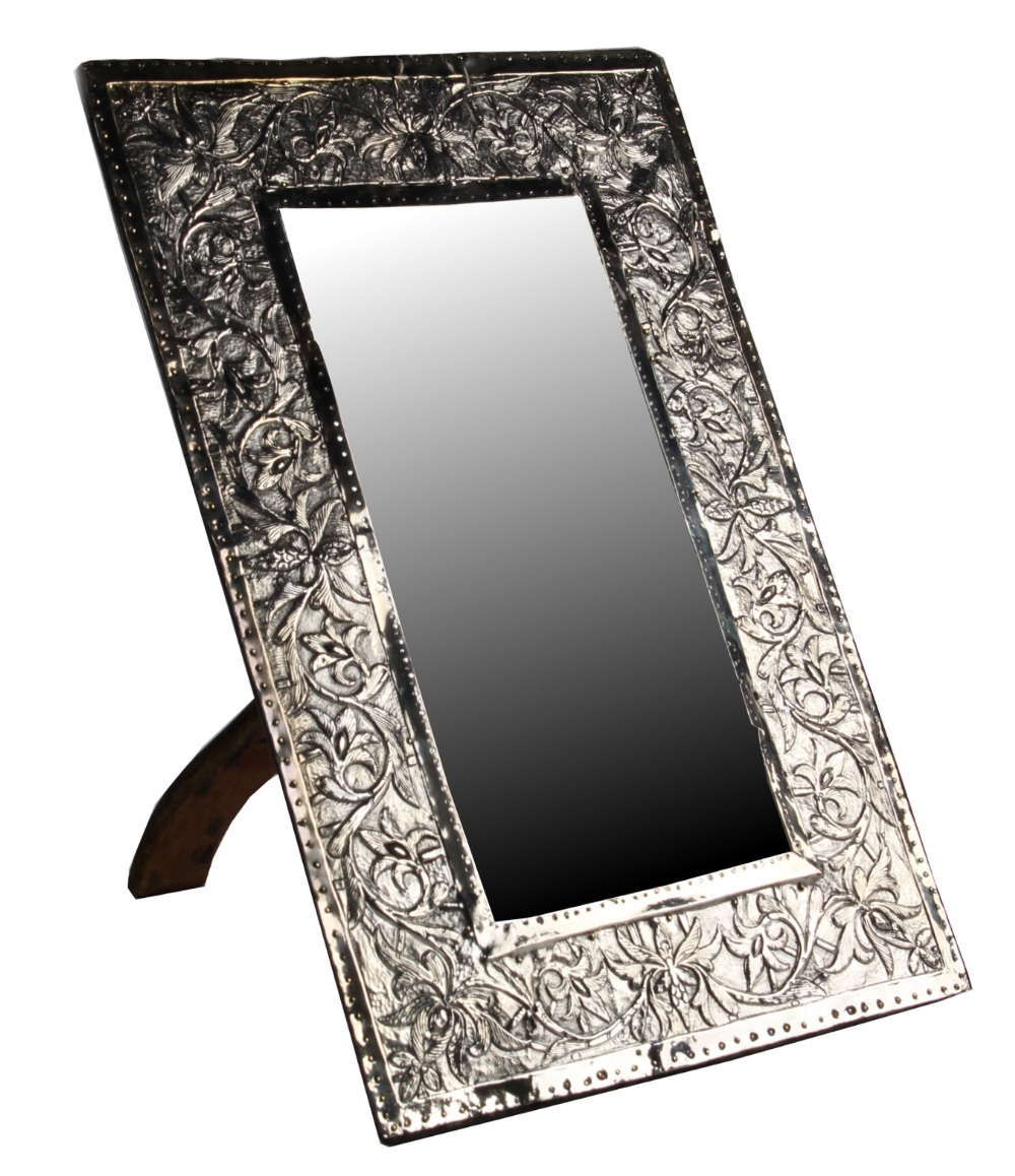 An early 20th century white metal rectangular framed easel mirror, probably Colonial Indian,