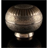 Property of a lady - an Indian white metal bun shaped box, 8.85ins. (22.5cms.) diameter,