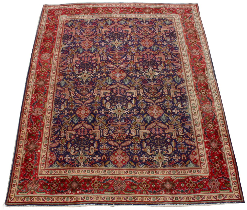 Property of a lady - a large Persian hand knotted wool carpet, second half 20th century, with navy