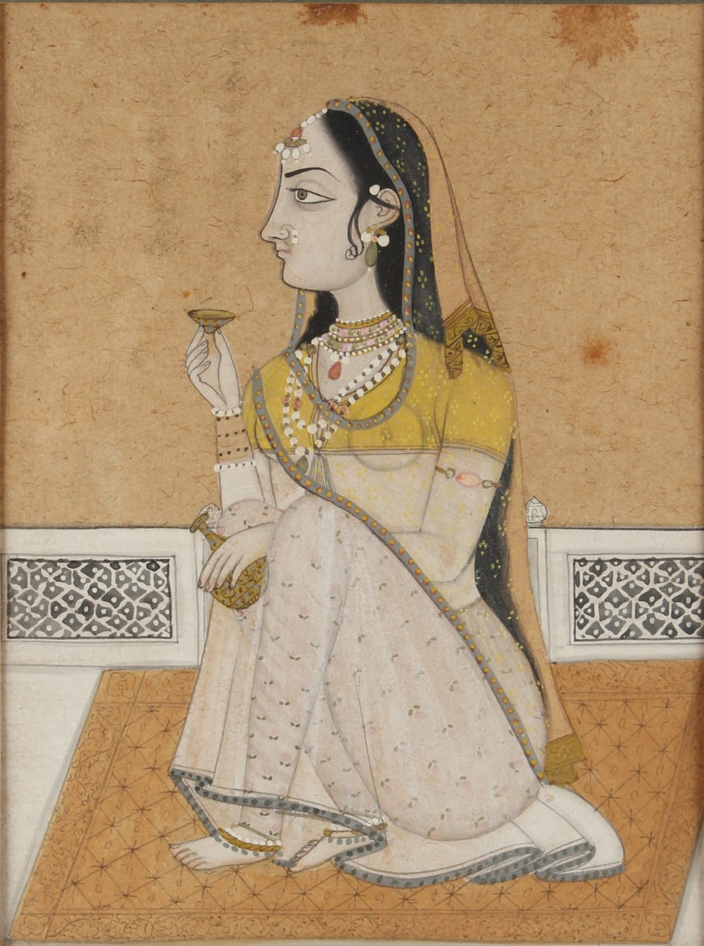 An Indian watercolour & gouache painting depicting a seated lady, late 19th / early 20th century,
