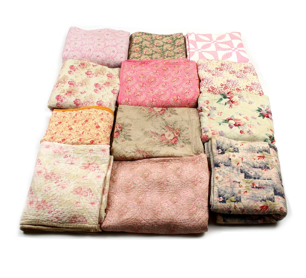 Property of a deceased estate - a collection of twelve floral quilts (12) (see illustration).