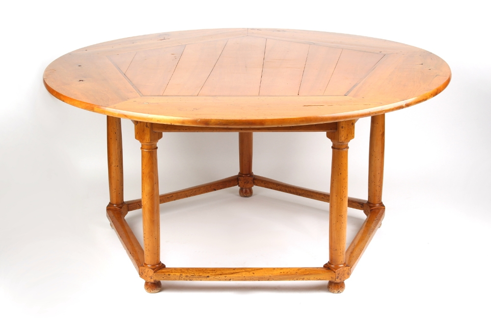 Property of a gentleman - a Continental chestnut circular topped dining table with five turned