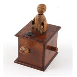 A Japanese wooden Kobe toy, one arm missing, 5.7ins. (14.5cms.) high (see illustration).
