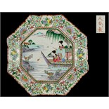An early 20th century Japanese octagonal plate, painted with ladies fishing from a boat, red 3-