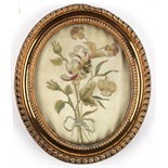 Property of a lady - a small George III gilt oval framed silkwork picture of flowers, with old