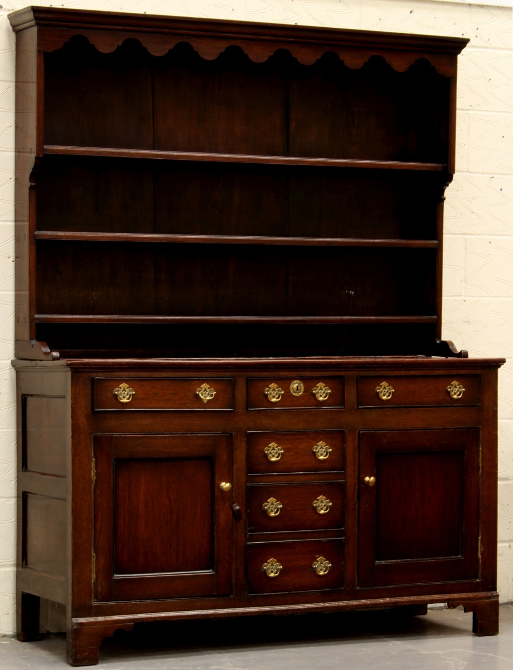Lot 112 - Property of a deceased estate - a George III oak two-part Welsh dresser, 63ins. (160cms.) wide (