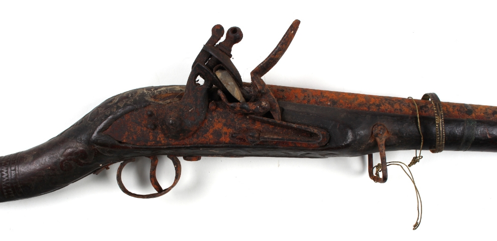 An early 19th century Middle Eastern flintlock jezail, with carved decoration to stock, 66ins. ( - Image 2 of 2