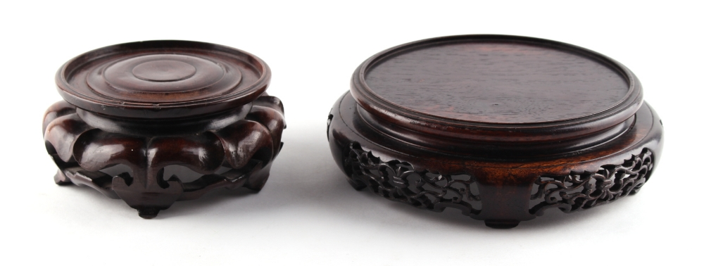 Lot 217 - Property of a lady - two Chinese carved hardwood stands, early 20th century, one damaged, the larger