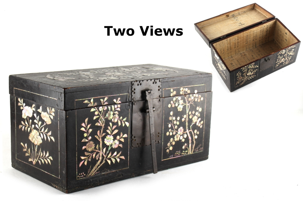 A 19th century Japanese mother-of-pearl inlaid rectangular box or caddy, 13.4ins. (34cms.) wide (see