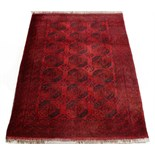 Property of a lady - an early / mid 20th century Turkoman carpet with three columns of octagonal
