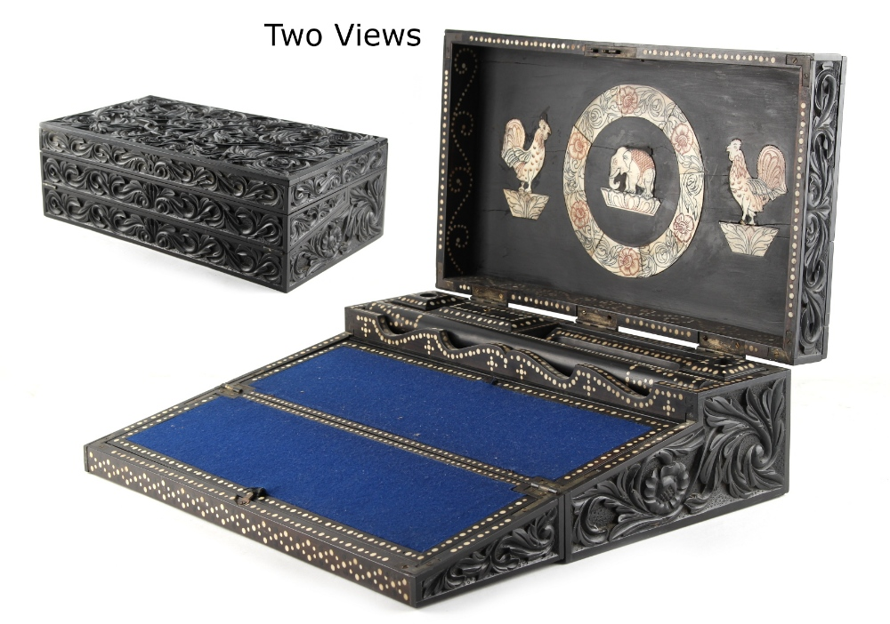 Lot 8 - An Anglo Celanese or Colonial Indian carved ebony writing box, mid 19th century, the interior with