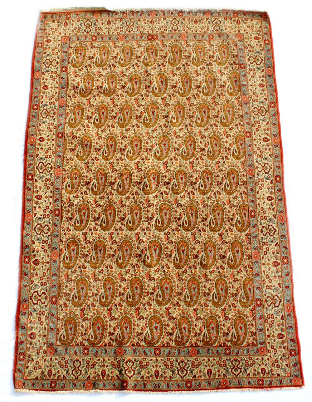 Property of a lady - an early / mid 20th century Persian Qum rug, with boteh field & ivory ground,