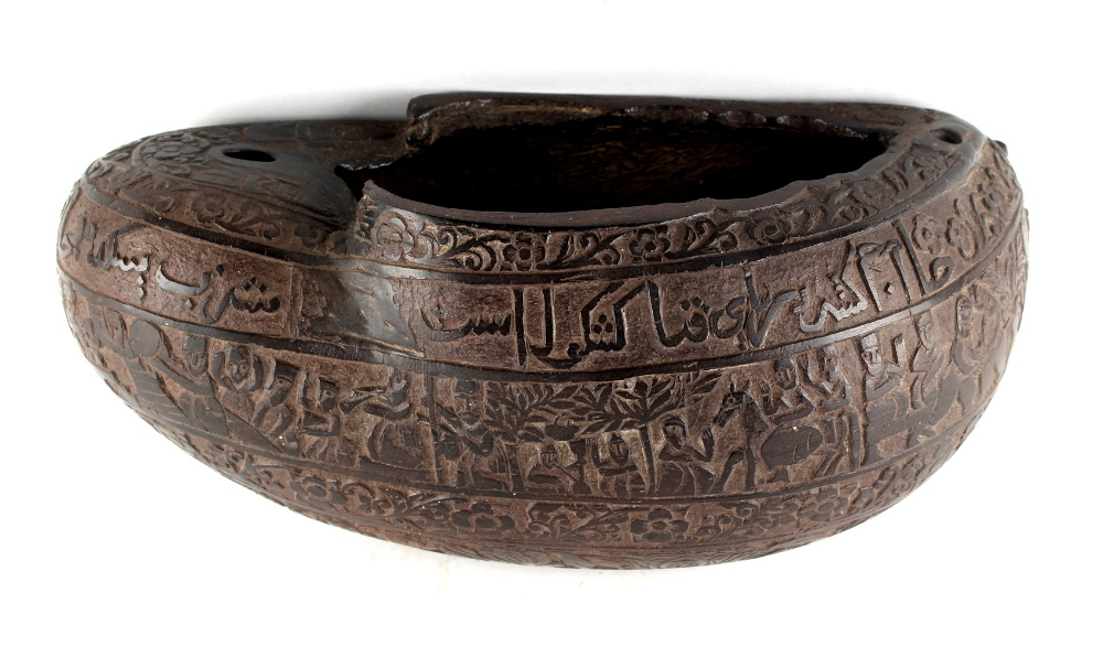 Property of a lady - a 19th century Persian Qajar carved coco de mer begging bowl, kashkul, carved
