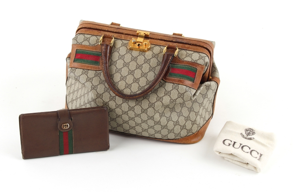 Property of a deceased estate - a Gucci holdall; together with a Gucci leather purse, in original