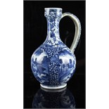 A Japanese blue & white ewer, late 17th / early 18th century, damages & restorations, 11ins. (