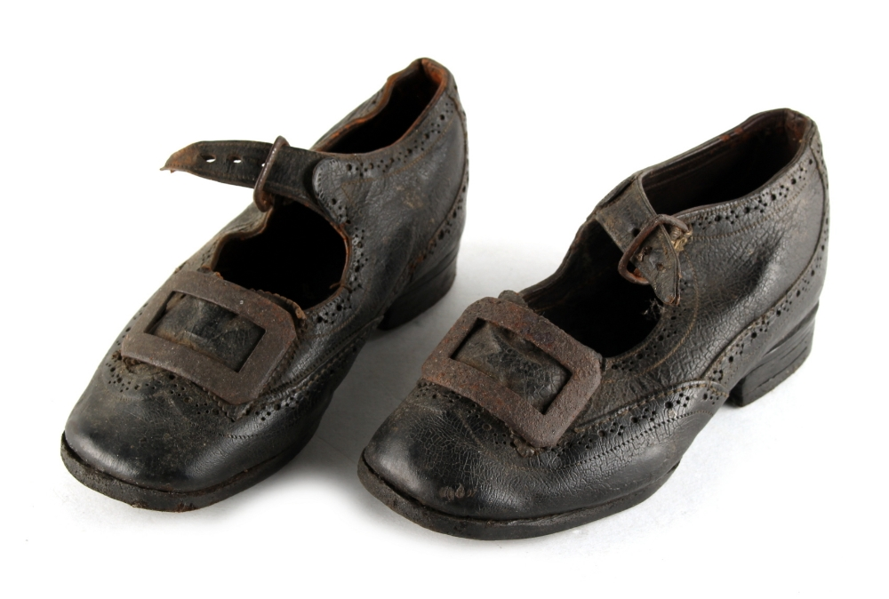 Property of a gentleman - a pair of Victorian child's black leather brogue shoes, with steel buckles