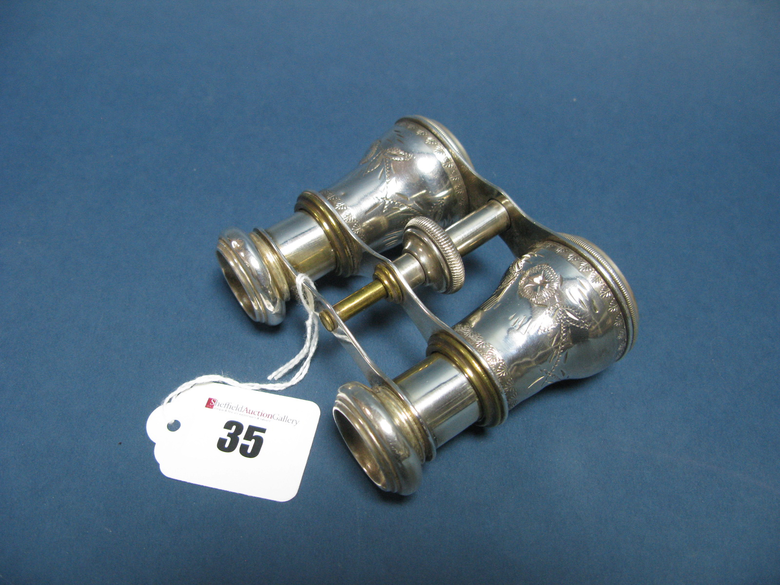 Lot 35 - A Pair of Decorative Opera Glasses, with Aesthetic style decoration (one glass lens damaged).