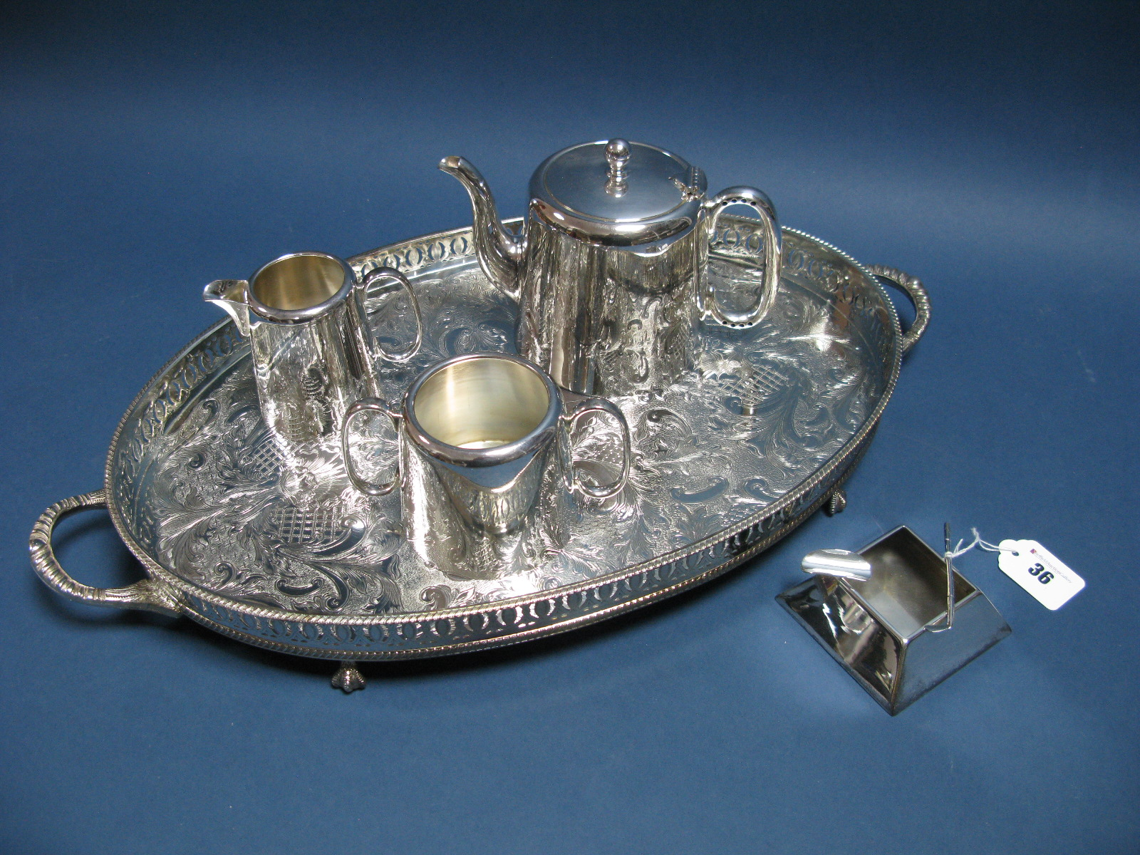 Lot 36 - An Art Deco Style Plated Ashtray, of square form with applied golf club; together with a plated