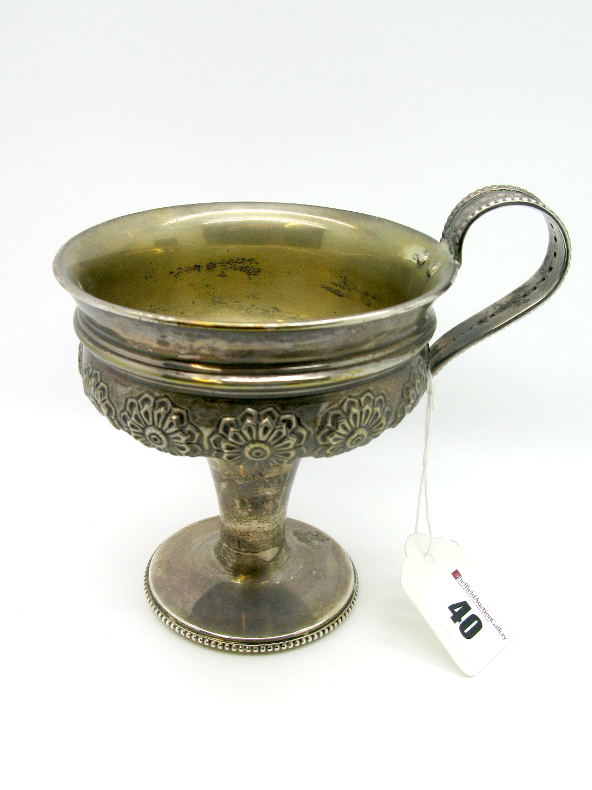 Lot 40 - A Decorative Hallmarked Silver Pedestal Cup, Nathan & Hayes, Chester 1907, the shallow circular bowl