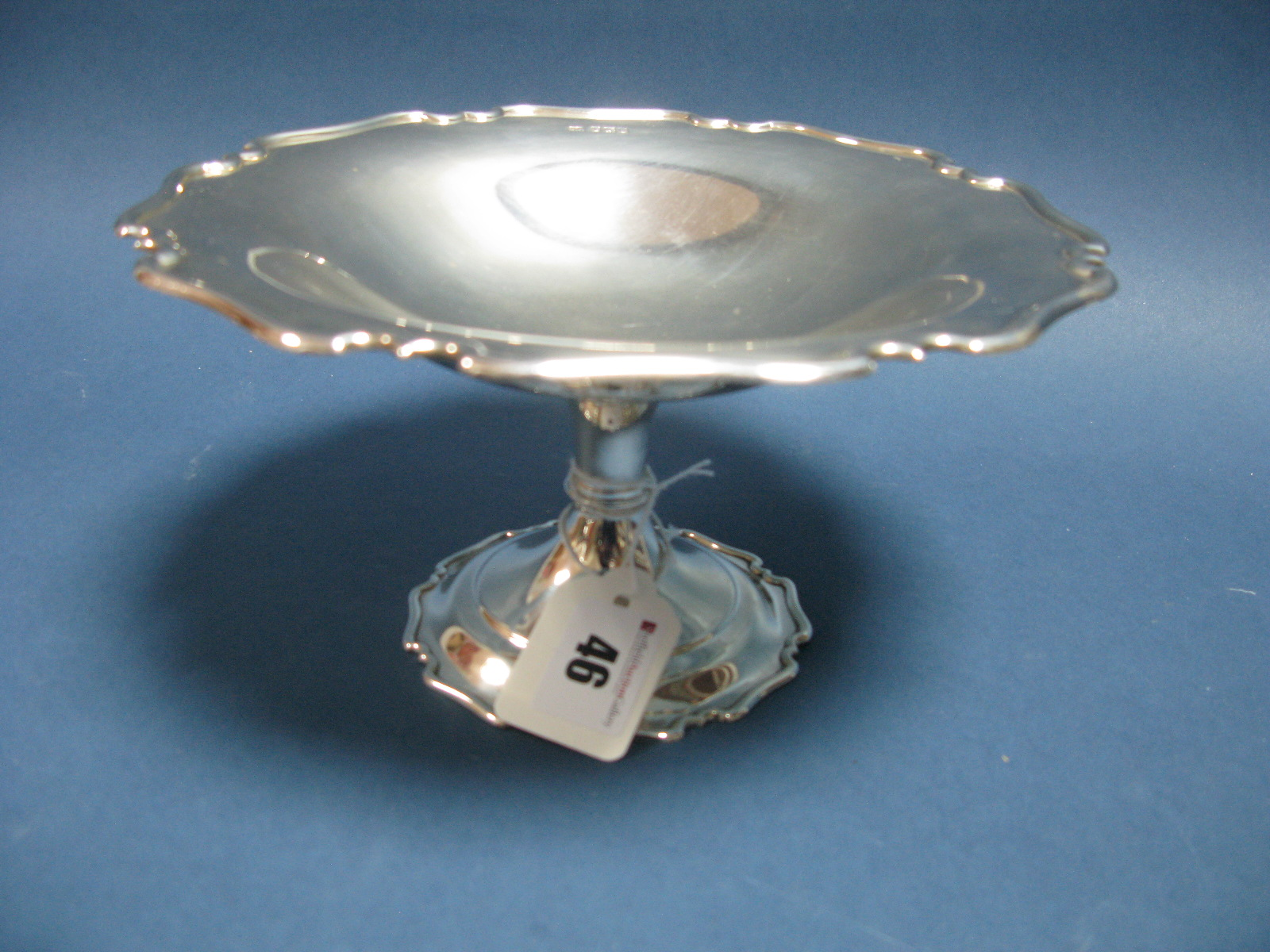 Lot 46 - A Hallmarked Silver Pedestal Dish, Atkin Bros, Sheffield 1921, of shaped circular form, on knopped