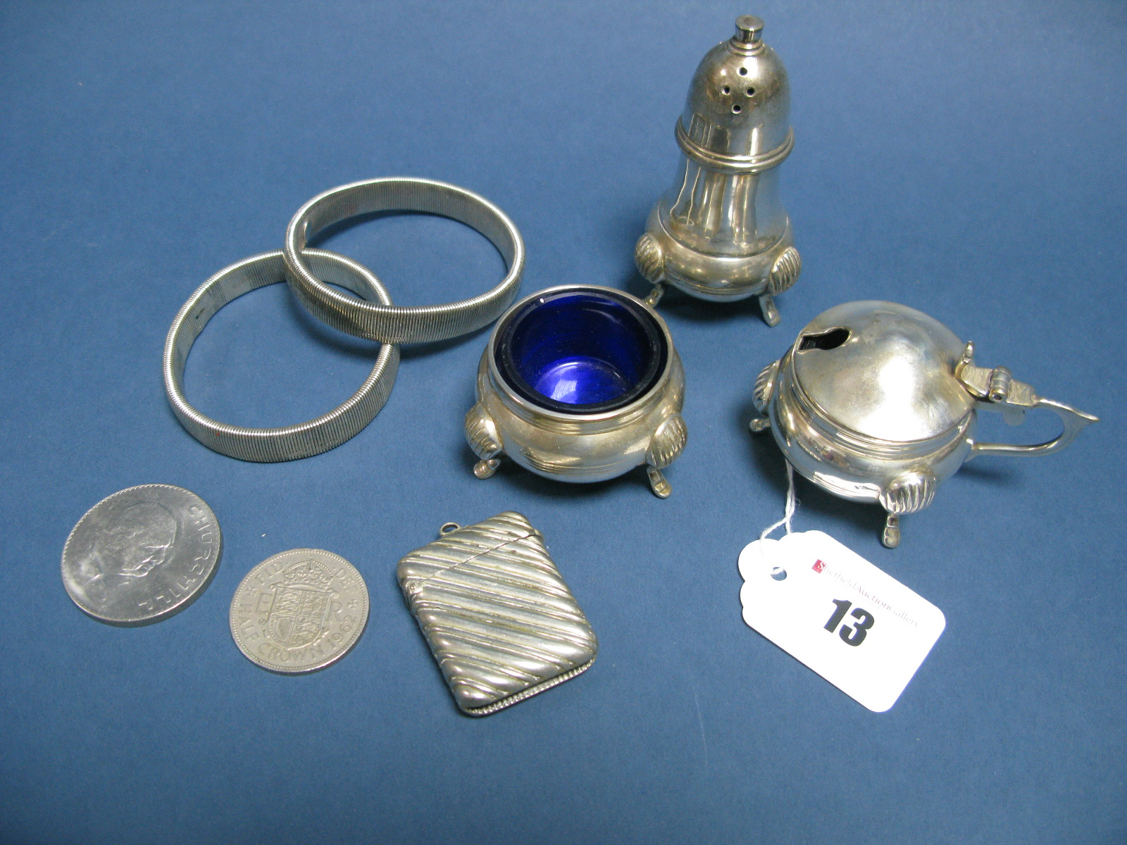 Lot 13 - A Three Piece Plated Cruet, a vesta case allover detailed in relief, coins, etc.